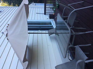 For Sale Patio Table with 4 Chairs and Umbrella asking $75.