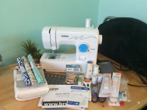 Brand new sewing machine and supplies!
