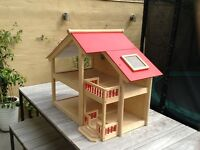 Wooden dolls house by Pintoy