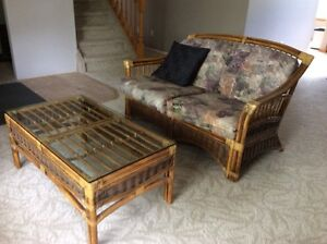 Wicker loveseat and glass top coffee table. Will se