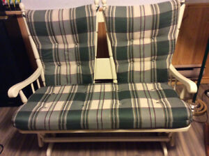 Relax in comfort .Great condition double glider/rocker.