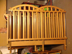 European light wood crib and bedding