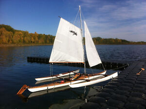 Custom seakayak with sail and outriggers