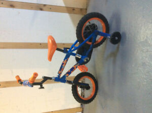 Kids bike with extension handle