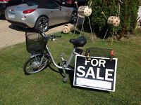 New.  Three wheel electric bike