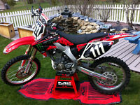 CRF250R 2005,Next to New,Stand, Loading Ramp,oils,parts.