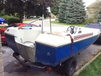 $175  deck boat trailer and motor