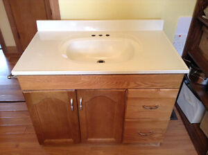 Large bathroom sink with cupboard