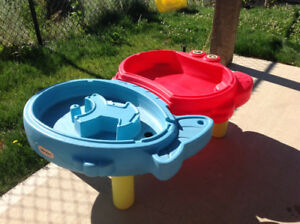 2 water and sand tables. Great for hot day outside play.