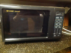 a SHARP microwave oven-small size
