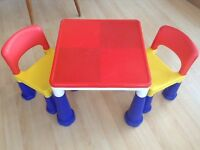 Children's play table and chairs set. Bright hard wearing plastic adaptable Lego top.