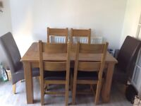 Harvey's Solid Oak Dining room table & chairs.