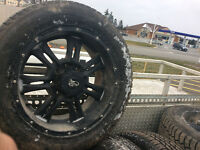 "Ford 3/4 or one ton 20"" alloy wheels and studded tires $700.00"