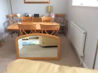 Beautiful extending dining table with 6 chairs,dresser & mirror