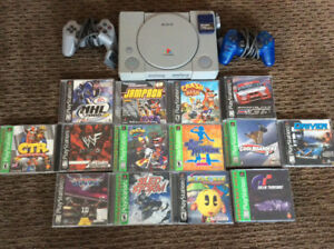 PlayStation with 14 games and 2 consoles