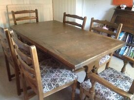 Dark wood table and chairs seats 6