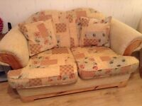 Farmhouse/country cottage style 2 seater sofa and matching armchair.