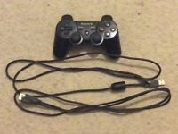 PlayStation 3 with 4 games and a controller