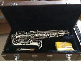 Silver saxophone with case
