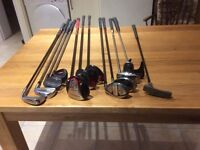 Various right handed golf clubs.