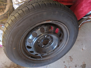 Set of 4 tires on rim, very good condition!