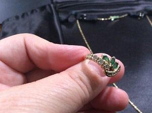 Bague avec 3  émeraudes et  9 diamants