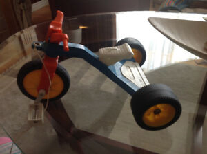 Vintage 1979 doll pull toy bike
