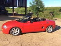 1999 solar red MG mgf convertible sports car