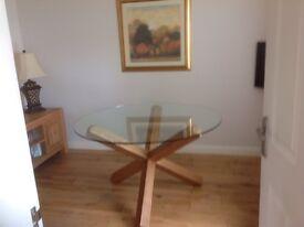 Circular Glass Top Dining Table.
