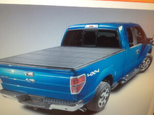 Rev hard folding cover.  Like new , Fit  on a Gmc Duramax 2016,