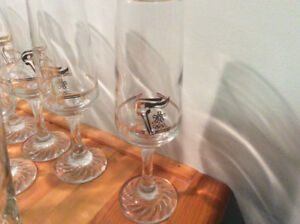 8  champagne flutes/water glasses gold logo from the 88 Olympics