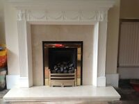 Fire surround including gas fire