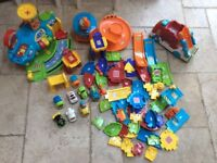Large Toot Toot bundle, including airport, transporter and 9 vehicles
