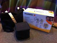 MEDELA FREESTYLE BREASTPUMP, £50, used for 1 week in 2011