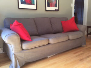 IKEA sofa with extra white cover in good condition.