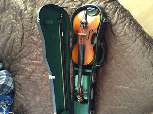 Quarter size violin, bow and case