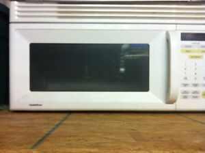 Microwave never used white for above stove mount $75.00