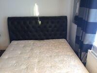 Stunning super king size bed frame (black leather)