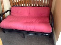 Sofa Bed. Metal frame, red mattress, good condition