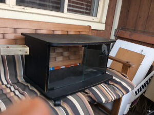 Small TV stand with glass doors
