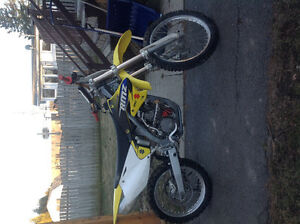 Mint rmz250.  Will consider trade on 4x4 atv