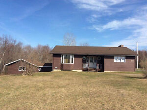 Bungalow w/ Attached Garage on 4 acre Riverfront Property