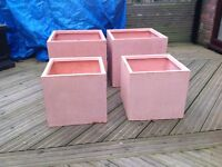 Two smaller terracotta fibrecotta planters