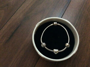 Anniversary addition pandora bracket with love charm
