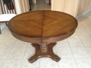Round Wood Dining Table  -  Includes 1 Leaf for Extension