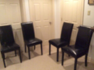 4 black vinyl leather chairs