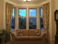 Good quality curtains, tie backs and complementary cushion covers