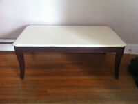 solid coffee table measures 4 feet wide x 2ft 3 inches deep