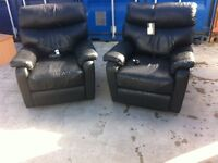 2 x Black leather electric. Chairs