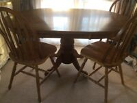 Solid wood dining table and 4 chairs. Shabby chic